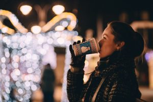 Woman having warm drink during the holidays